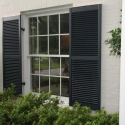 Stylish-Dark-Exterior-Window-Shutters-and-Clear-Glass-Windows-near-White-Pillars-and-Green-Plantations-1024x683